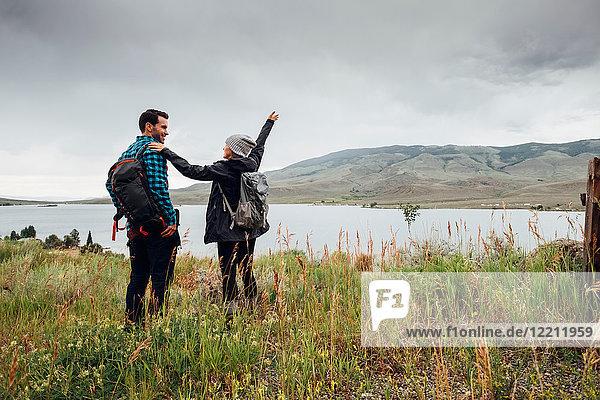 Couple hiking  standing beside Dillon Reservoir  Silverthorne  Colorado  USA