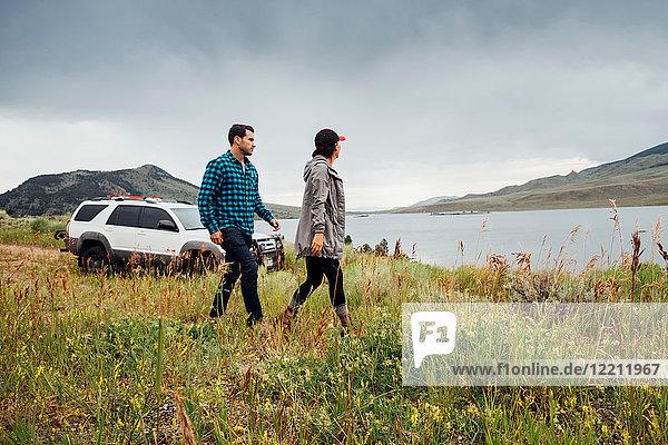 Couple walking beside Dillon Reservoir  Silverthorne  Colorado  USA