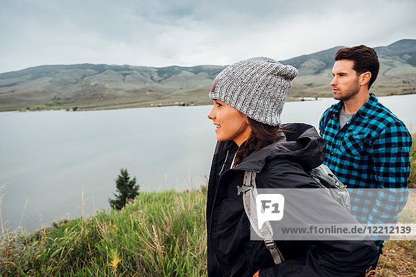 Couple hiking  standing beside Dillon Reservoir  looking at view  Silverthorne  Colorado  USA