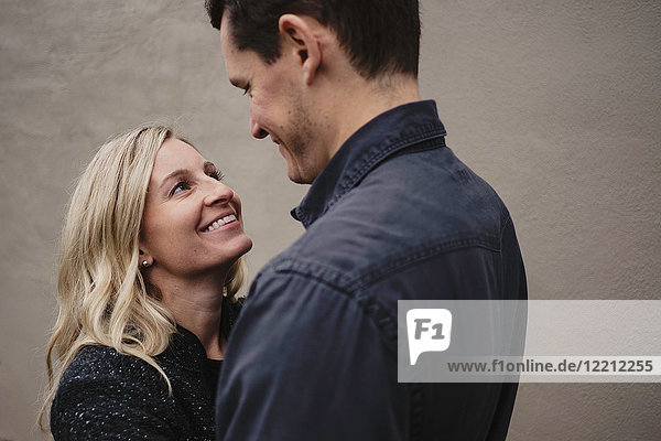 Portrait of mid adult couple  face to face  smiling
