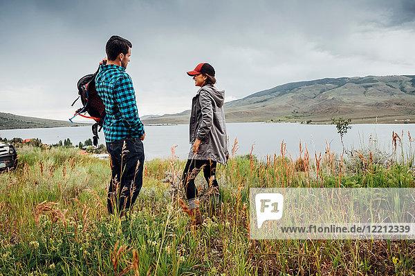 Couple standing beside Dillon Reservoir  Silverthorne  Colorado  USA