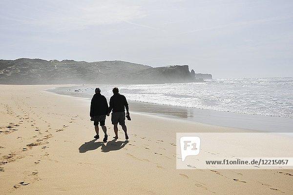 Walking in Bordeira beach. Carrapateira  Algarve. Portugal.