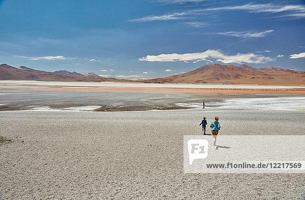 Mother and sons exploring landscape  Laguna Colorada  Colorada  Potosi  Bolivia  South America