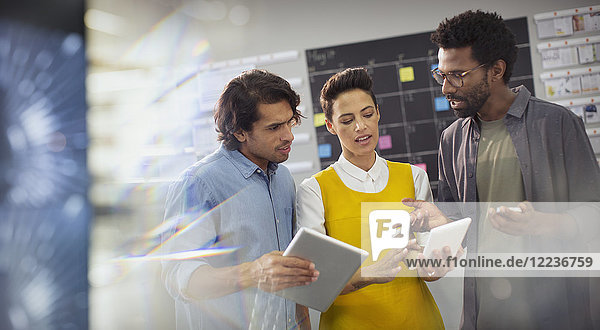 Creative business people planning  using digital tablets in office