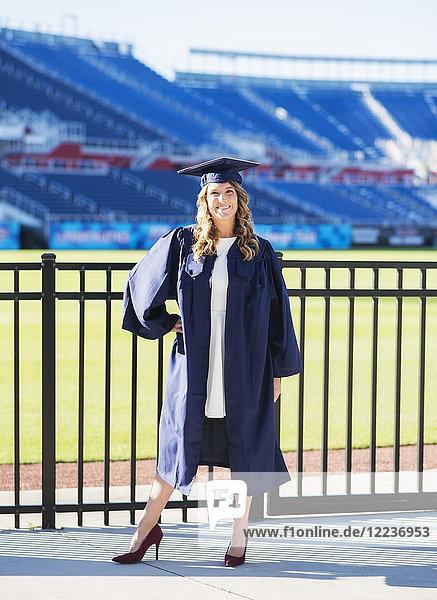 Portrait of graduate student in stadium Portrait of graduate student in stadium