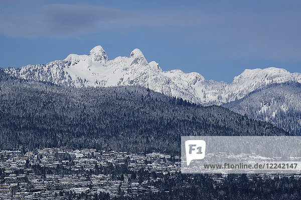 The Lions with the British Properties residential area in West Vancouver in winter  British Columbia  Canada