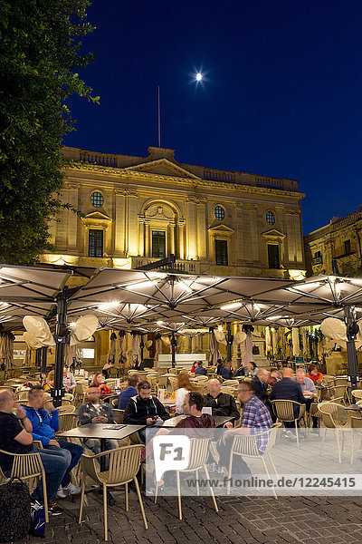 Night time outdoor restaurants in Piazza Regina in Valletta  European Capital of Culture 2018  Malta  Mediterranean  Europe