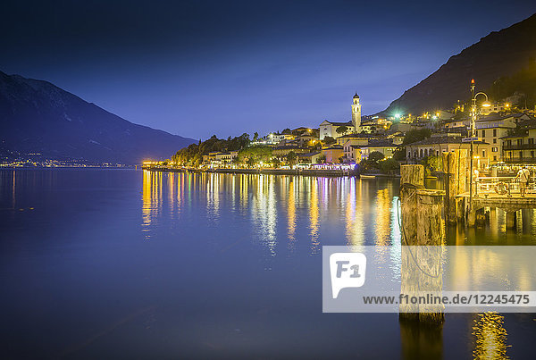 Panoramic view of Lake Garda and the port of Limone at dusk  Lake Garda  Lombardy  Italian Lakes  Italy  Europe