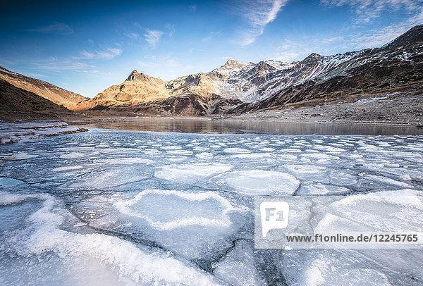 Frozen lake Montespluga at dawn  Chiavenna Valley  Sondrio province  Valtellina  Lombardy  Italy  Europe