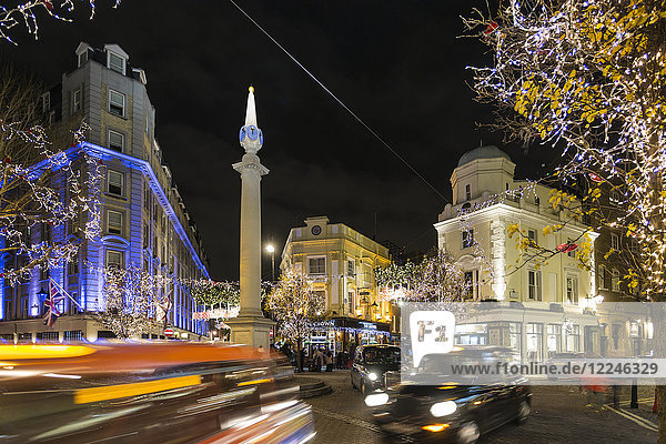 View of traffic at Seven Dials at night  London  England  United Kingdom  Europe