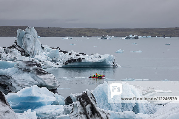Boat amongst calved ice from the Breidamerkurjokull glacier in Jokulsarlon glacial lagoon  Iceland  Polar Regions