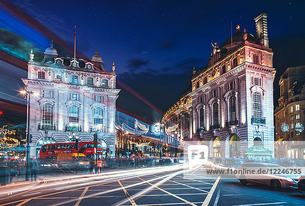 Traffic trails and festive Christmas lights at night  Piccadilly Circus  London  England  United Kingdom  Europe
