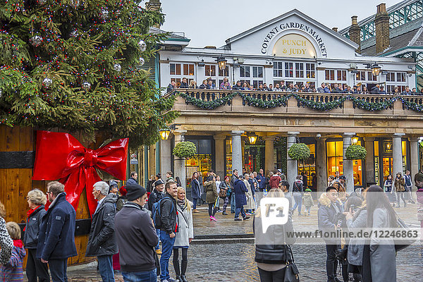 Visitors and Christmas decorations in Covent Garden Market  London  England  United Kingdom  Europe