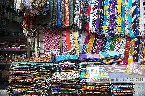 Colourful African fabrics on display in the market in Stone Town  Zanzibar  Tanzania  East Africa  Africa