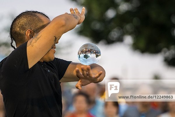 Juggler with crystal ball  Kulturufer  Festival with street artists  Friedrichshafen  Lake Constance  Baden-Württemberg  Germany  Europe