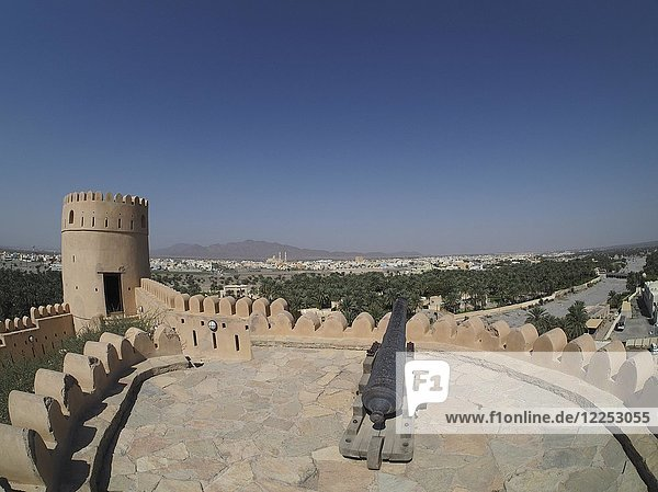 View of city  cannon on fortress Nakhl  Nakhl  Oman  Asia
