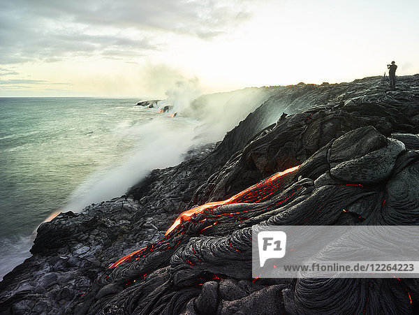 Hawaii  Big Island  Hawai'i Volcanoes National Park  lava flowing into pacific ocean  photographer