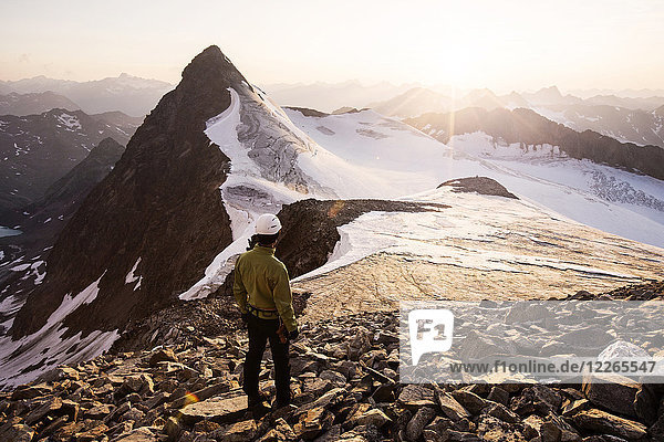 Austria  Tyrol  Stubaital  Stubai Alps  Wilder Pfaff  hiker looking to sunset  Zuckerhuetl left