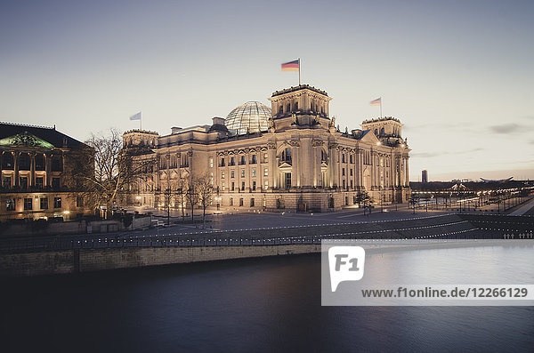 Germany  Berlin  Reichstag building at Spree river in the evening
