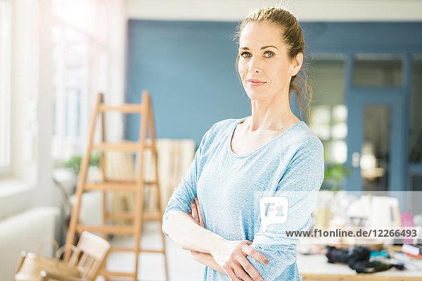 Woman refurbishing her new home  taking a break