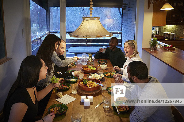 High angle view of multi-generation family enjoying meal at table