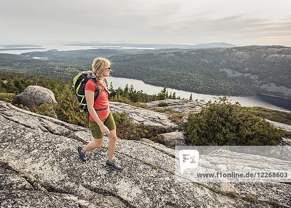 Woman hiking at summit of Pemetic Mountain  Acadia National Park  Maine  USA