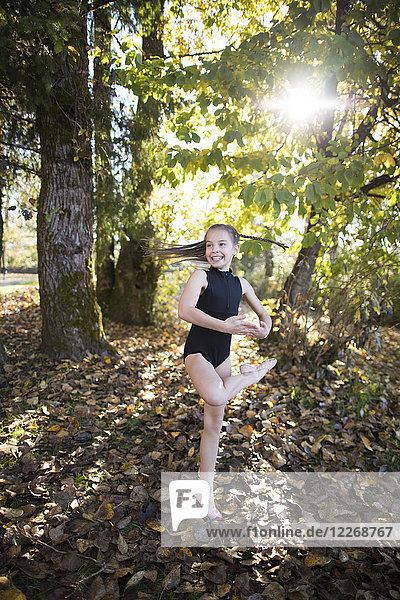 Portrait of young girl in ballet outfit performing ballet outdoors  British Columbia  Canada