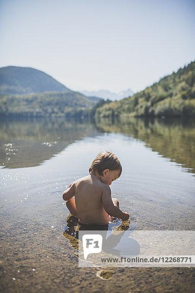 Baby boy playing in Hicks Lake  Harrison Hot Springs  British Columbia  Canada