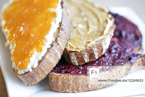 Sliced bread with jam  cheese  and nut butter