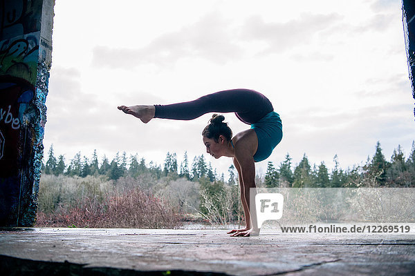 Girl practising yoga on outdoor stage