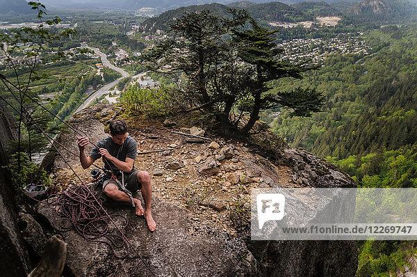 Man trad climbing at The Chief  Squamish  Canada