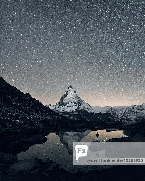 Matterhorn reflecting over Lake Riffelsee at night  Zermatt  Valais  Switzerland