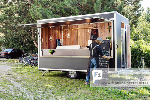 Man opening food truck for business  Innsbruck Tirol  Austria