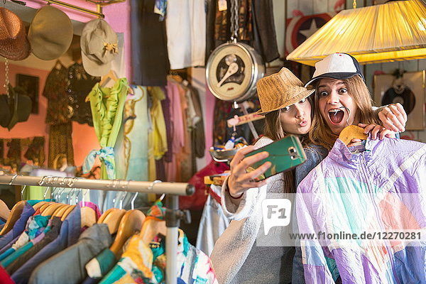 Friends taking selfie in thrift store