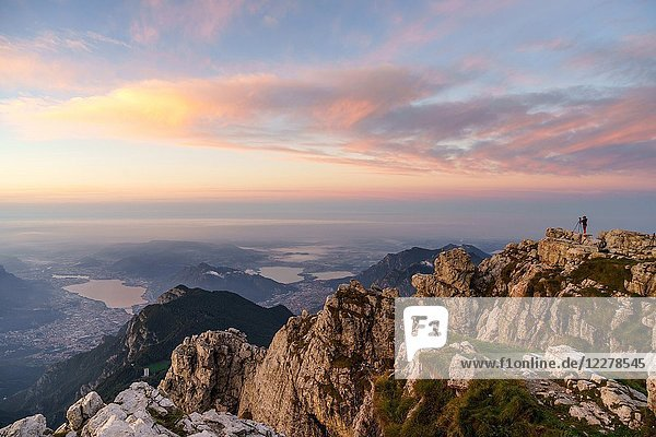 Photographer at the top of Grigna Meridionale at sunrise  Lecco  Lombardy  Italy  Europe.