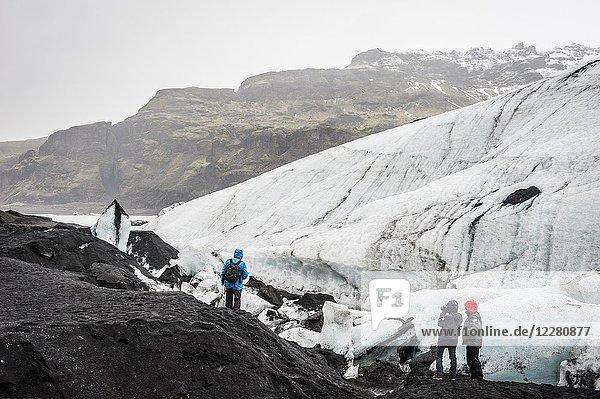 Tourists visiting Sólheimajökull glacier (region of Suðurland  Iceland).