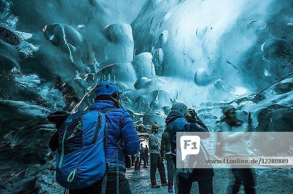 Ice cave tour in Breidamerkurjökull glacier  which is an outlet glacier of the larger glacier of Vatnajökull (region of Austurland  Iceland).