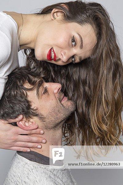 Couple portrait studio shot white background.