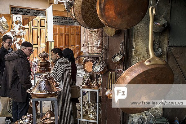 Customers and seller haggling  souk of brass  Place as Seffarine  medina. Fez. Morocco.