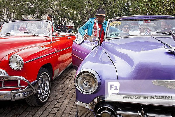 Taxis  Street scene in Parque Central  Centro Habana District  La Habana  Cuba.