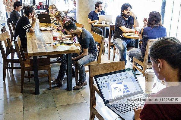 Argentina  Buenos Aires  Starbucks Coffee  cafe  coffeehouse  interior  customers  free wifi  laptop  man  woman  girl  boy  student  teen  Hispanic  Argentinean Argentinian Argentine South America American