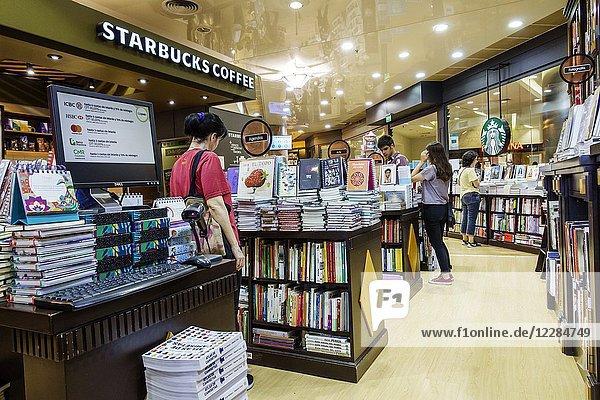 Argentina  Buenos Aires  Recoleta Mall  shopping  Starbucks Coffee  interior  Libreria Cuspide Books bookstore  retail  display  tables  man  woman  Hispanic  Argentinean Argentinian Argentine South America American
