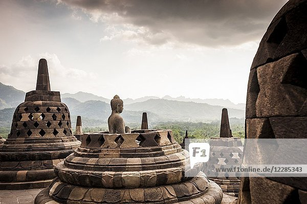 Statue of Buddha in Borobudur Temple  a UNESCO World Heritage Site in Magelang (Magelang Regency  Central Java  Indonesia).