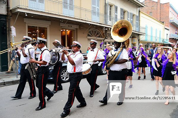A Second Line leads a procession through the French Quarter of New Orleans.