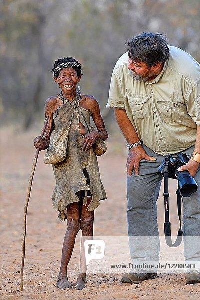 Old San woman (bushmen woman) and photographer  Kalahari  North Namibia  Namibia