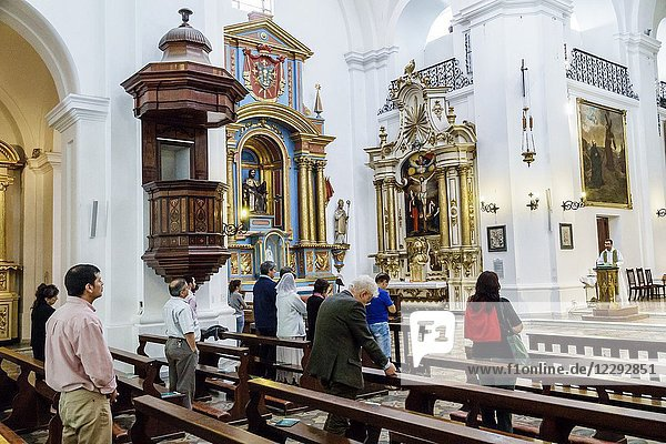 Argentina  Buenos Aires  Parroquia San Ignacio de Loyola  Catholic  church  religion  interior  pews  man  woman  mass  Hispanic  Argentinean Argentinian Argentine South America American