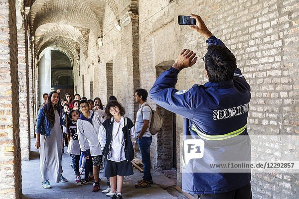Argentina  Buenos Aires  Manzana de las Luces  historical cultural complex  boy  girl  student  woman  class field trip  security guard  taking photo  smartphone  Hispanic  Argentinean Argentinian Argentine South America American