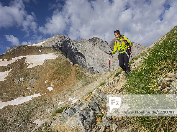 Woman hiking in the High Pyrenees  mount Vignemale  Cauterets  France