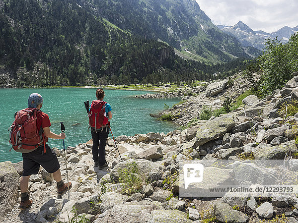 Man and woman hiking in the High Pyrenees near Gaube Lake  Cauterets  France