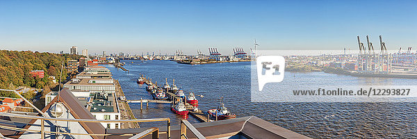 Panoramic view of harbor and buildings on River Elbe